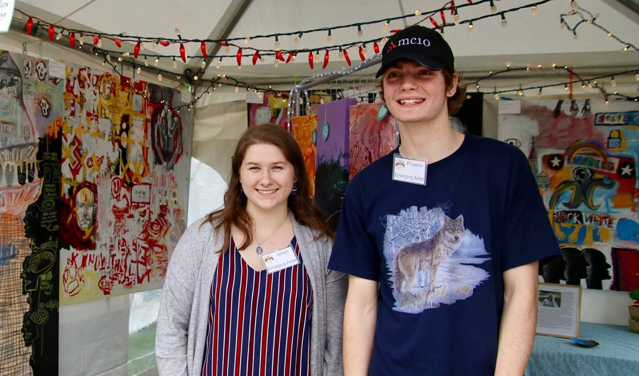 Gillian Mulder and a boy standing in front of an art display