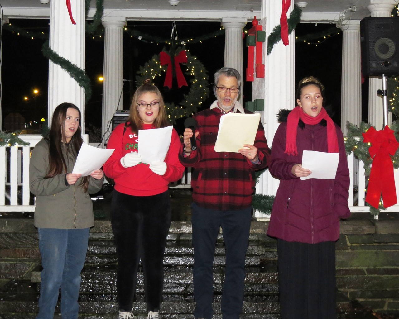 High school students singing Christmas carols on the park