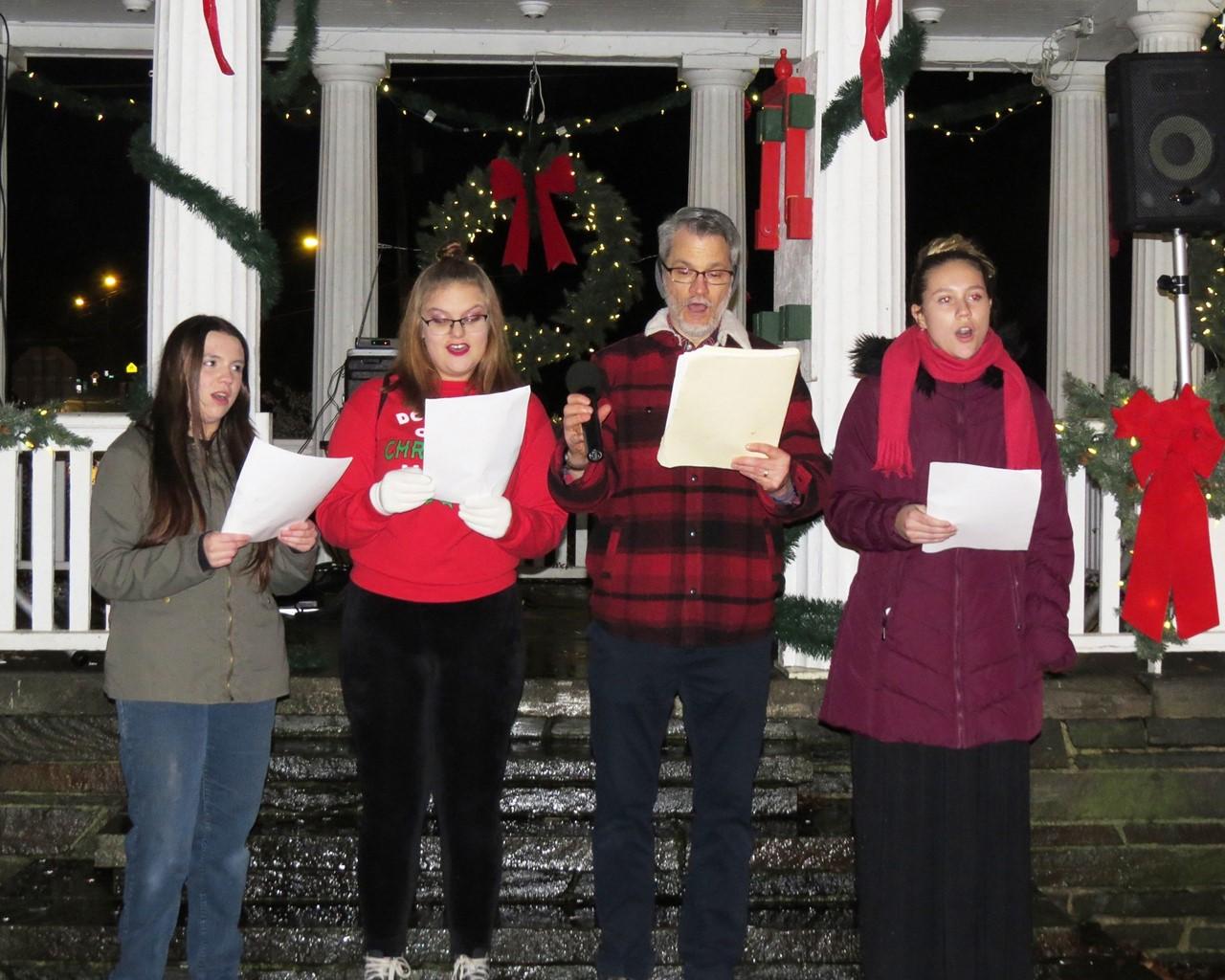 High school students singing Christmas carols on the park