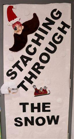 "Big mustache with words, ""Staching Through the Snow"""