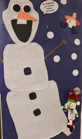 White snowman with blue background and snow