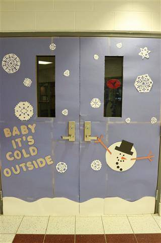 "snowflakes with saying, ""Baby it's cold outside"" and a snowman"