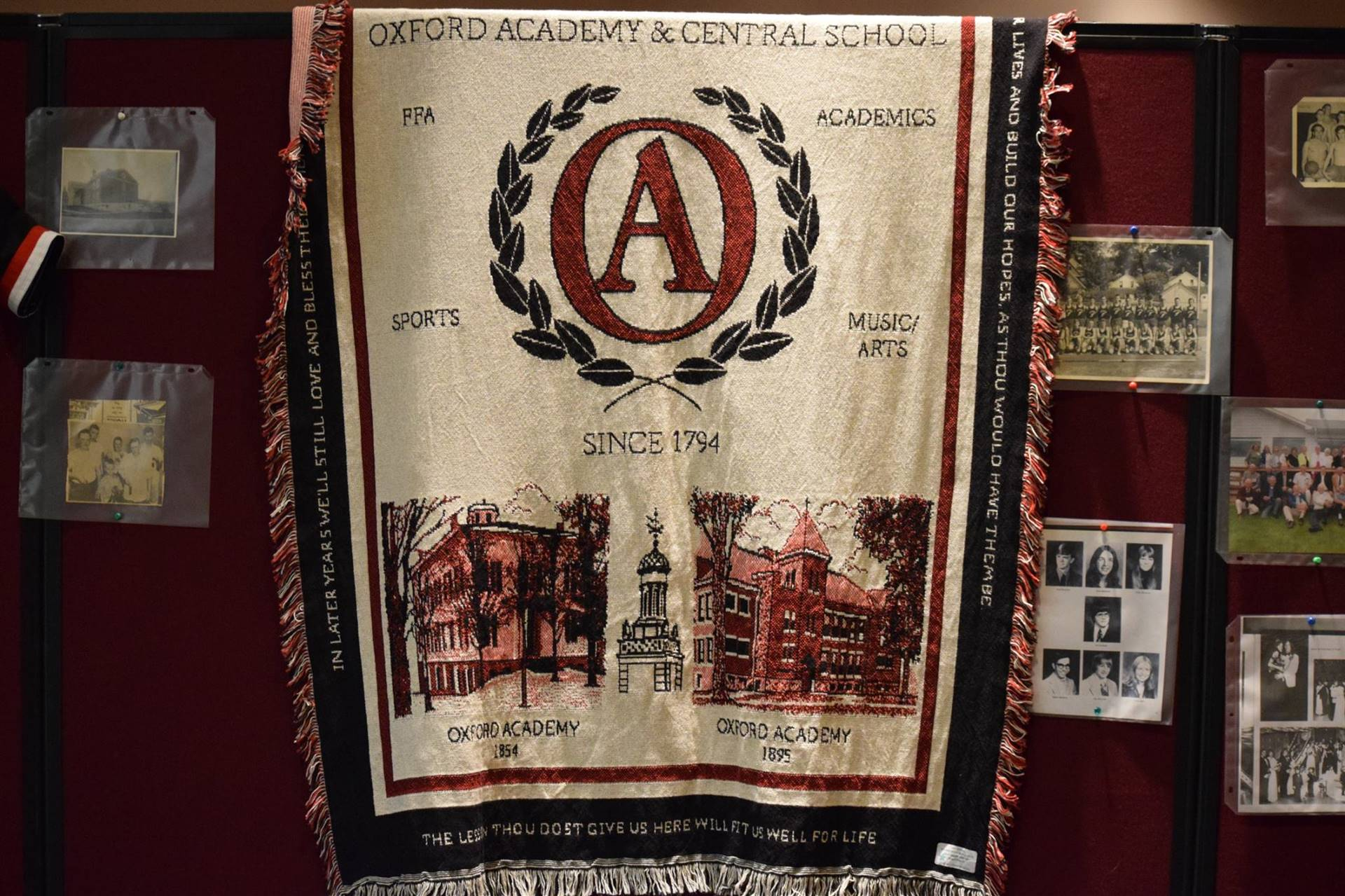 Display of Oxford Academy throw blanket.