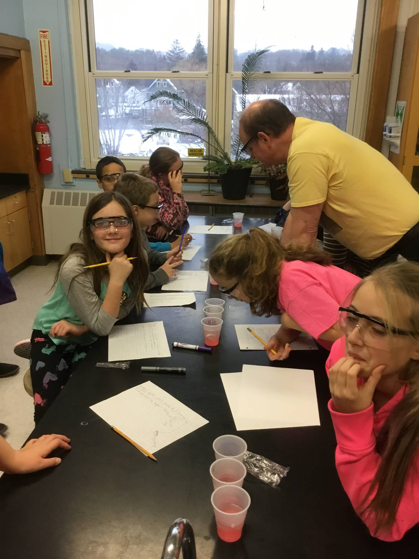 Mr. Champlin helps students with candy cane experiment