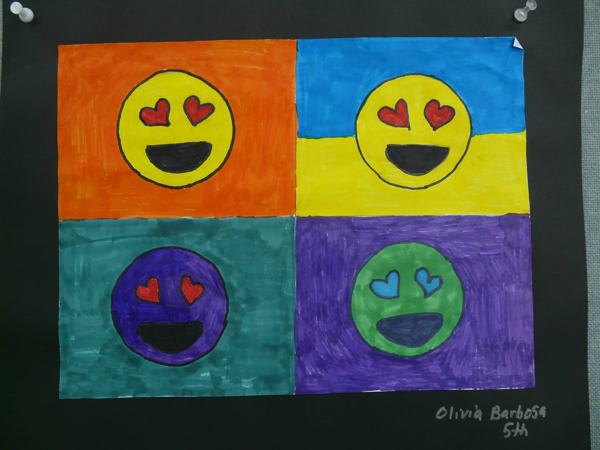 4 smiley faces in boxes-  all different colors with hearts at eyes