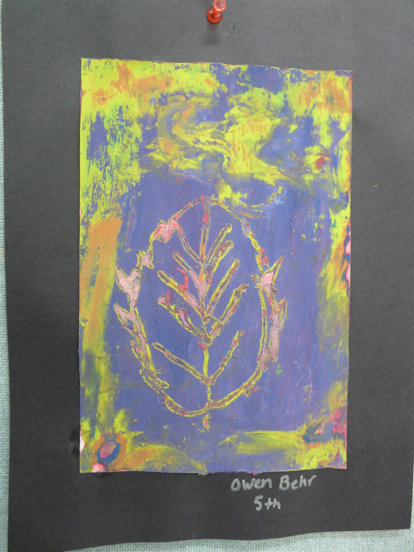outline of leaf on a tie-dyed page