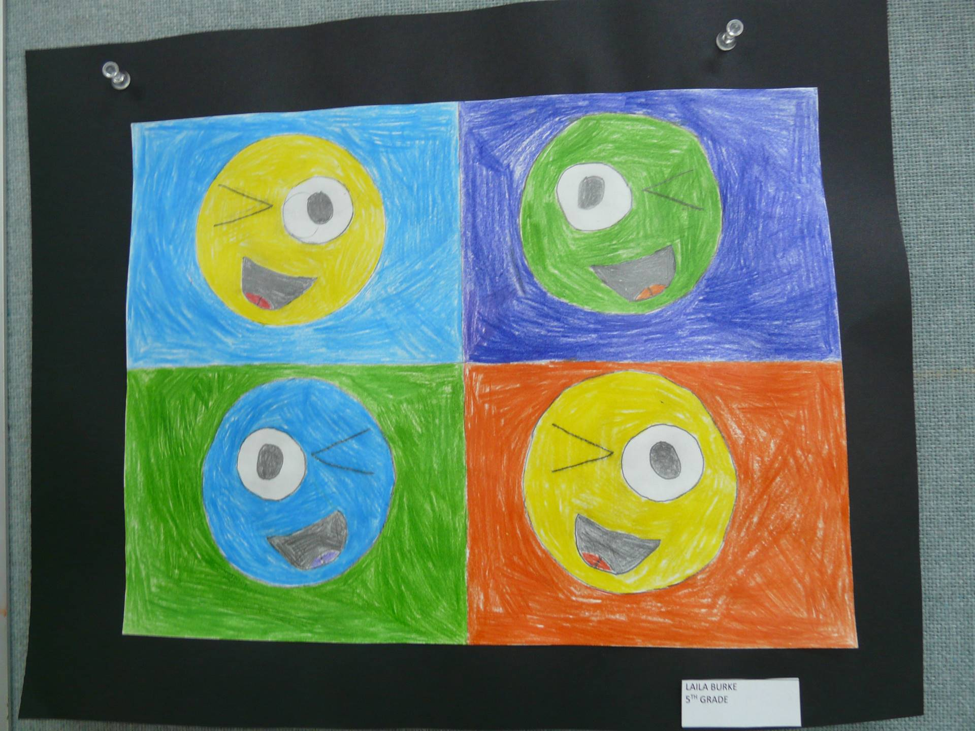4 smiley faces in boxes-  all different colors with winking eyes