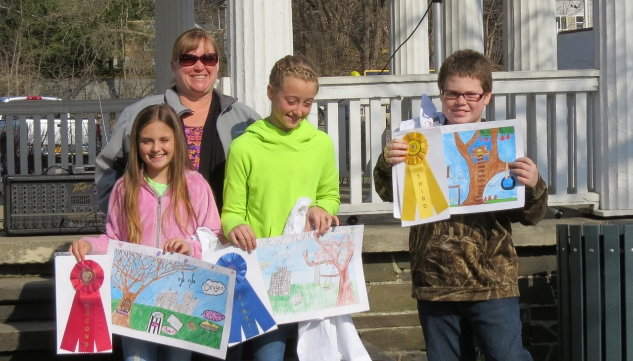 Students holding their Arbor Day posters that won awards