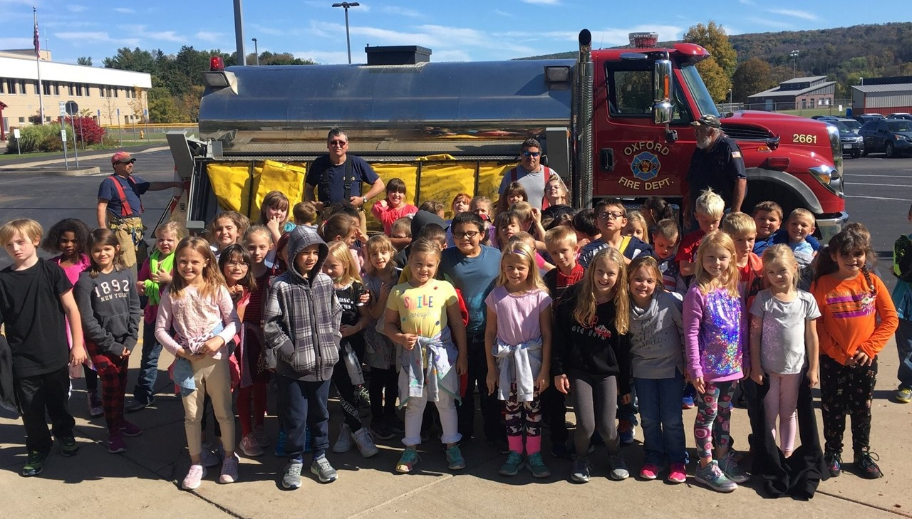 Primary School Students in front of a fire truck during fire safety week.