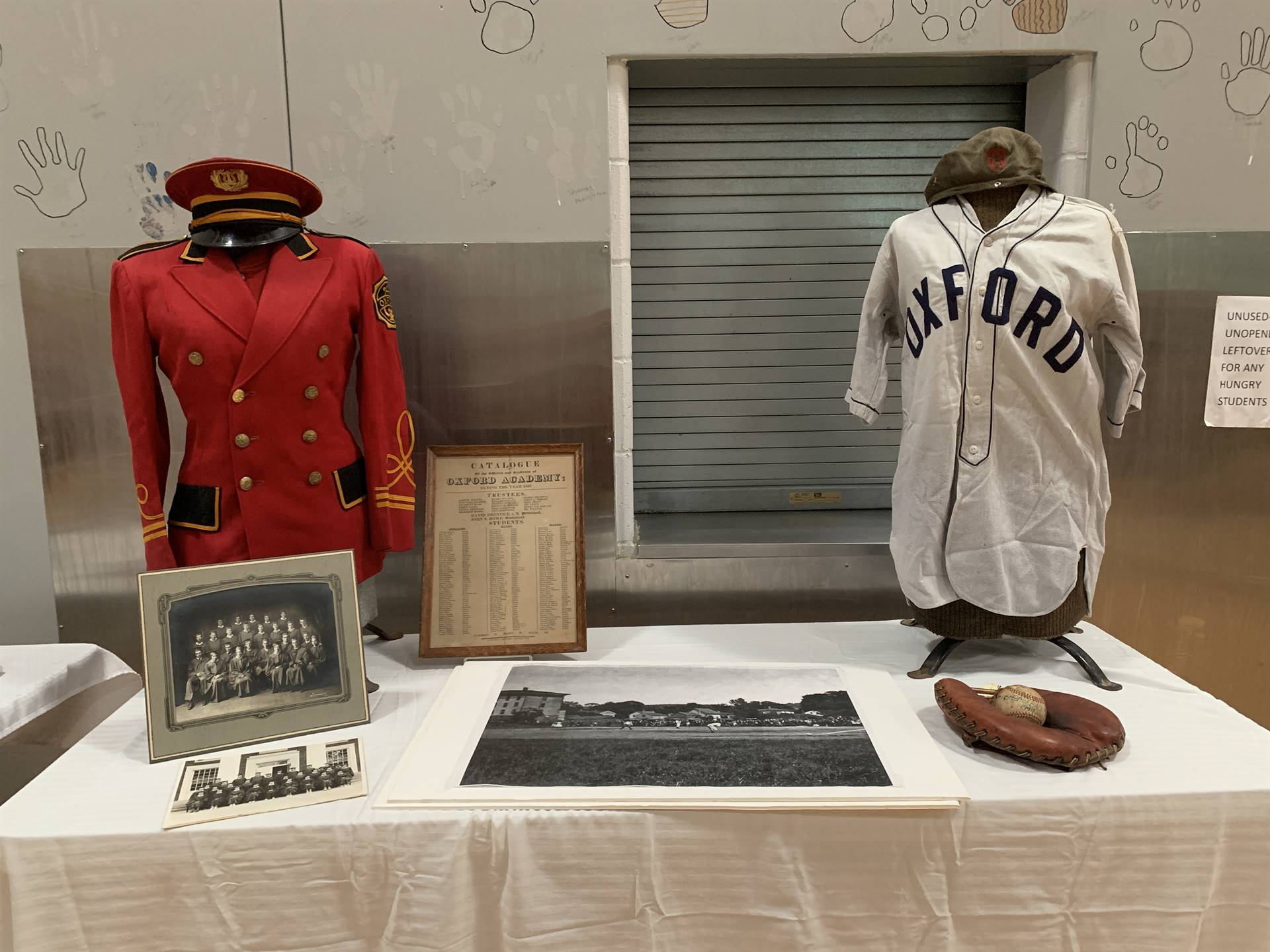 display table of old band and baseball uniforms