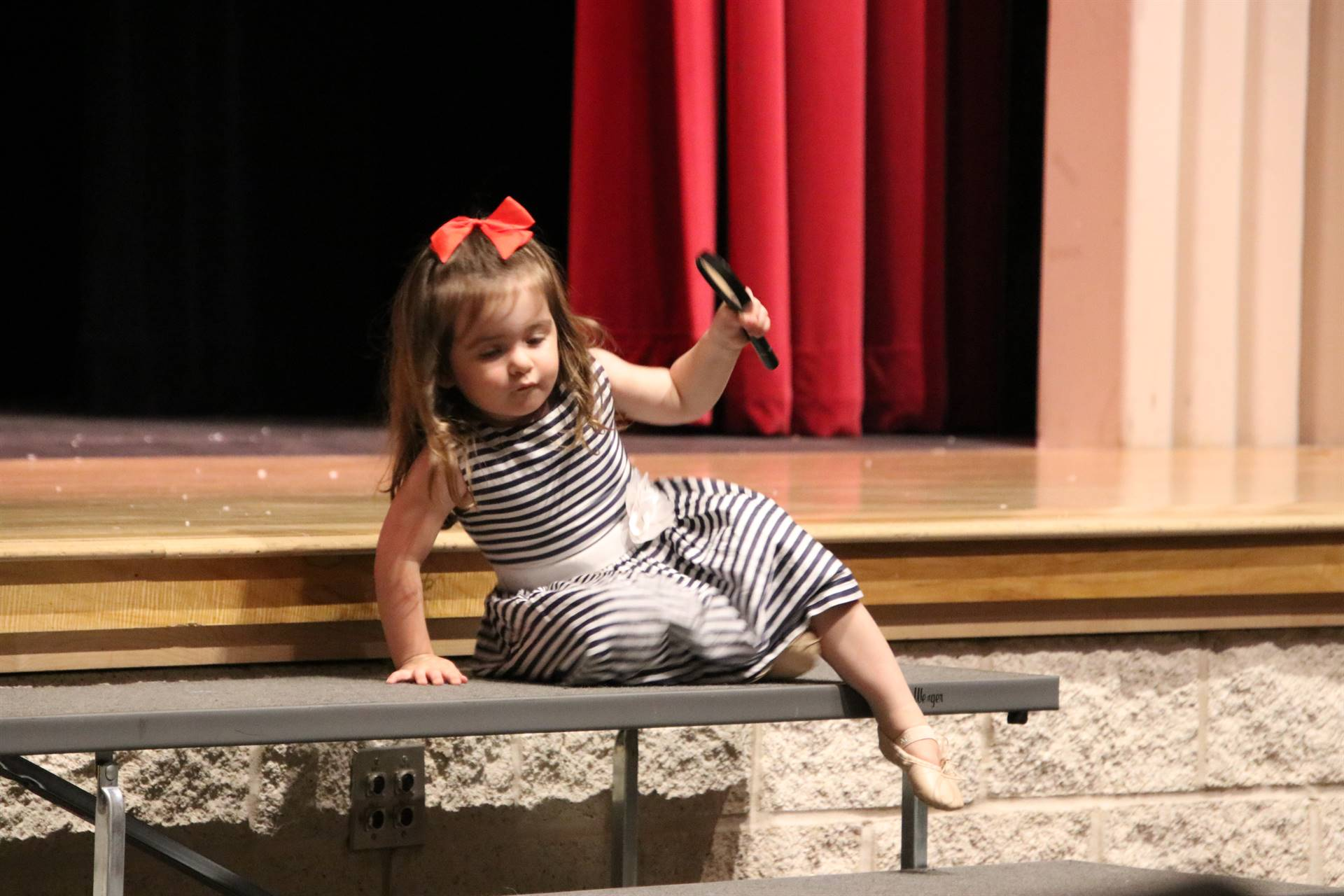 Dr. O'Reilly's daughter climbing off the stage