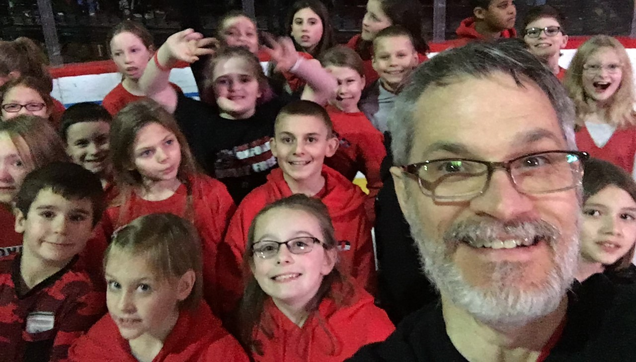 4th grade students taking a selfie with instructor before singing