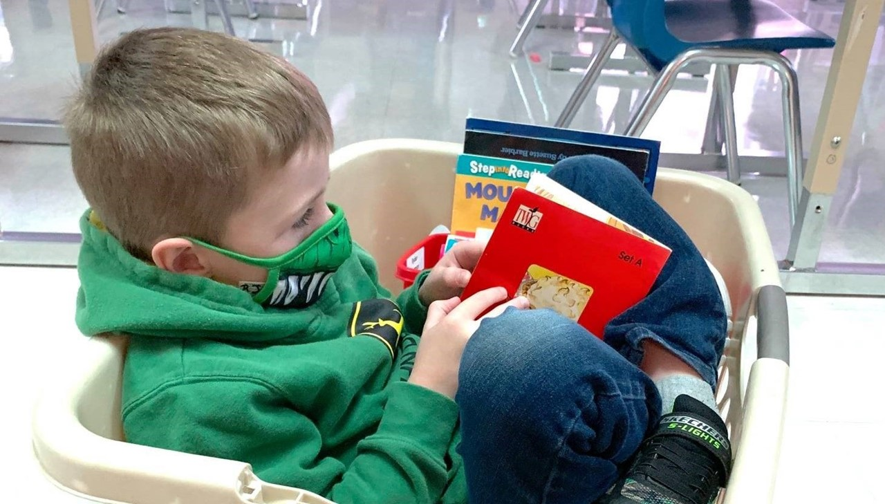 Student Reading In Basket