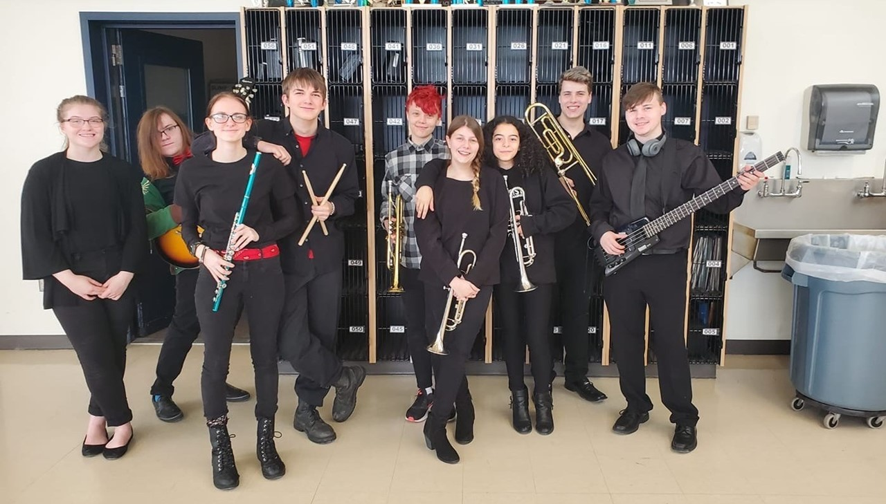 Music students posing with instruments