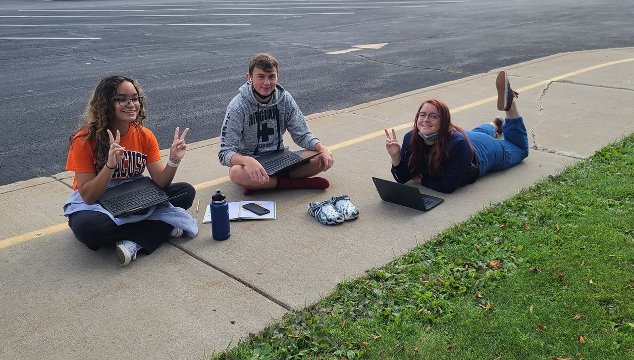 High School Students working on classwork outside