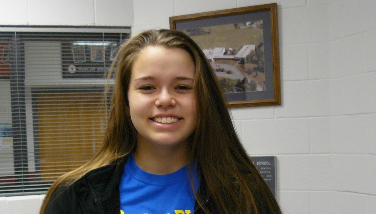 HS student of the month - female holding certificate