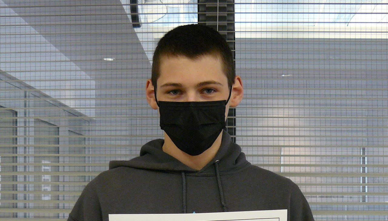 HS student of the month - male student holding certificate