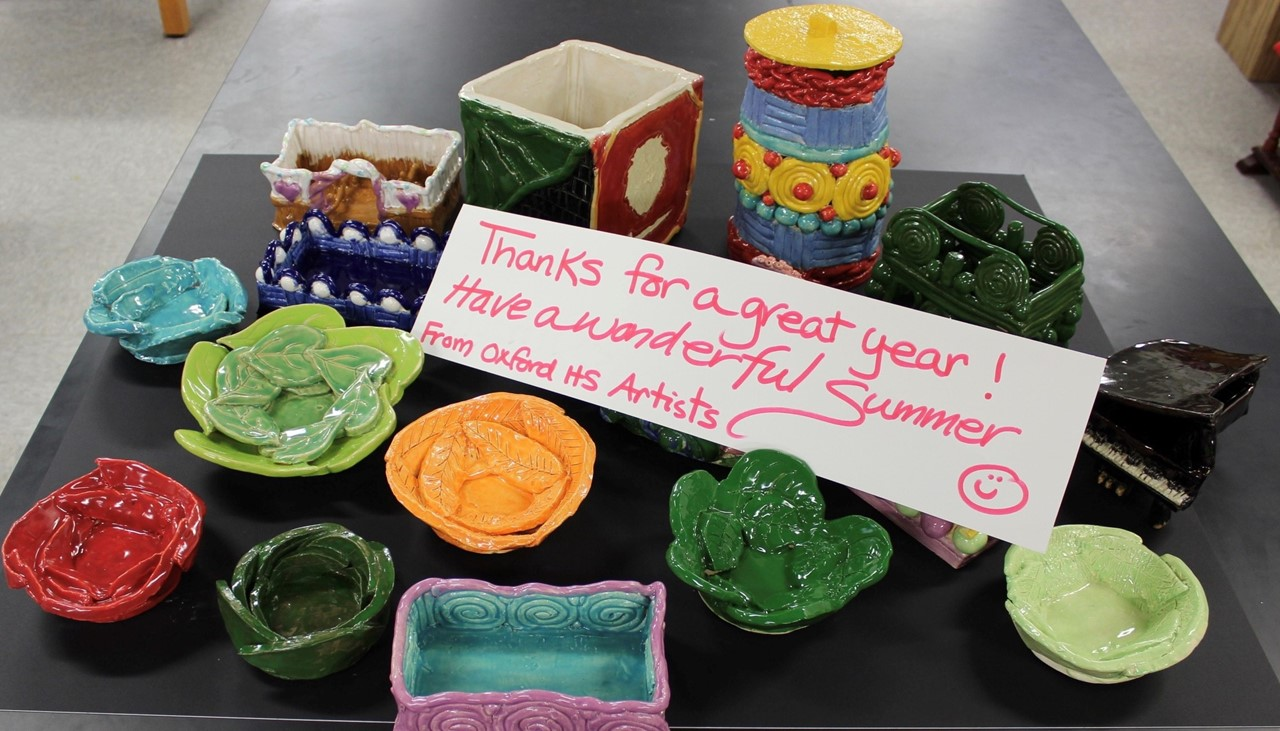 picture of clay art projects with a thank you for a great year note