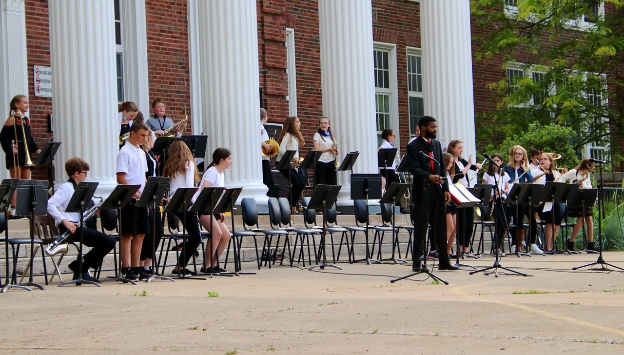 MS concert band students performing in front of the middle school
