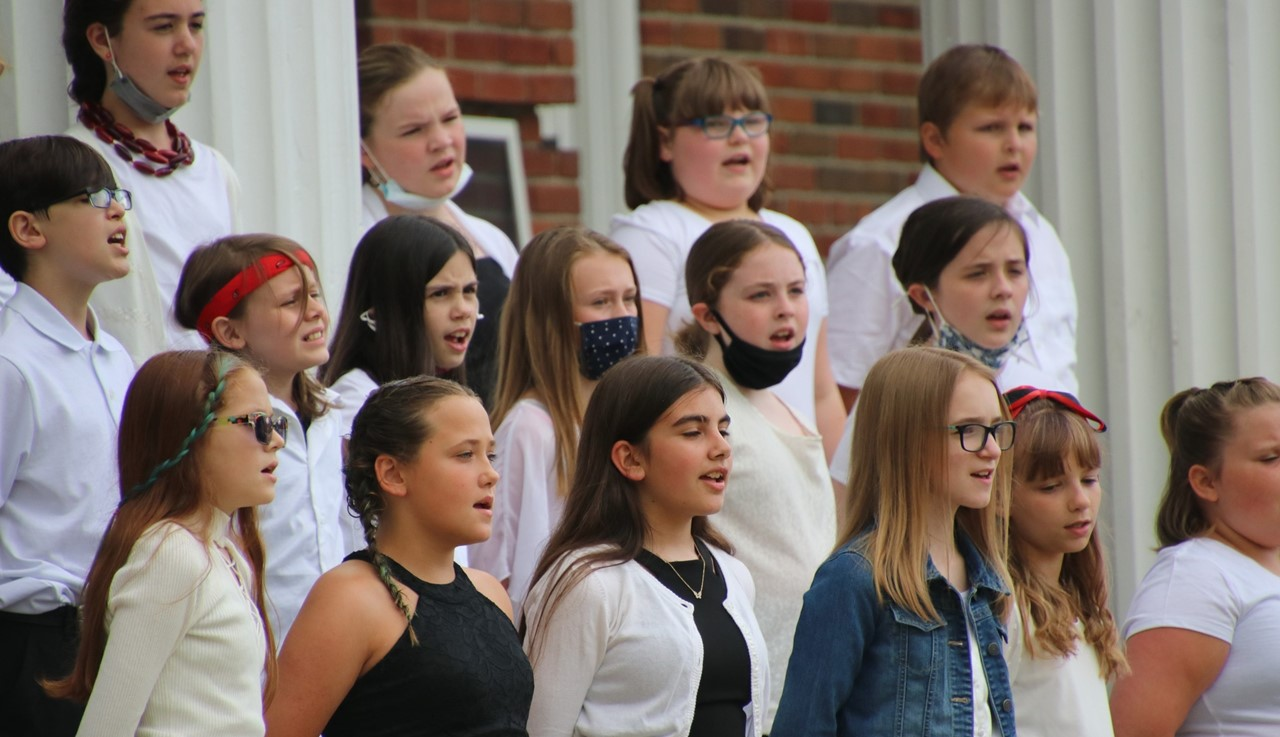 MS chorus performing in front of the middle school