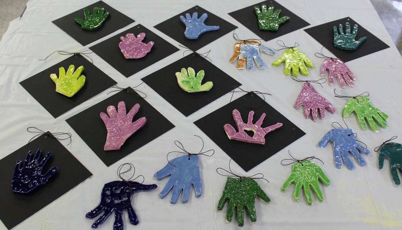 art work from summer program kids- clay handprints