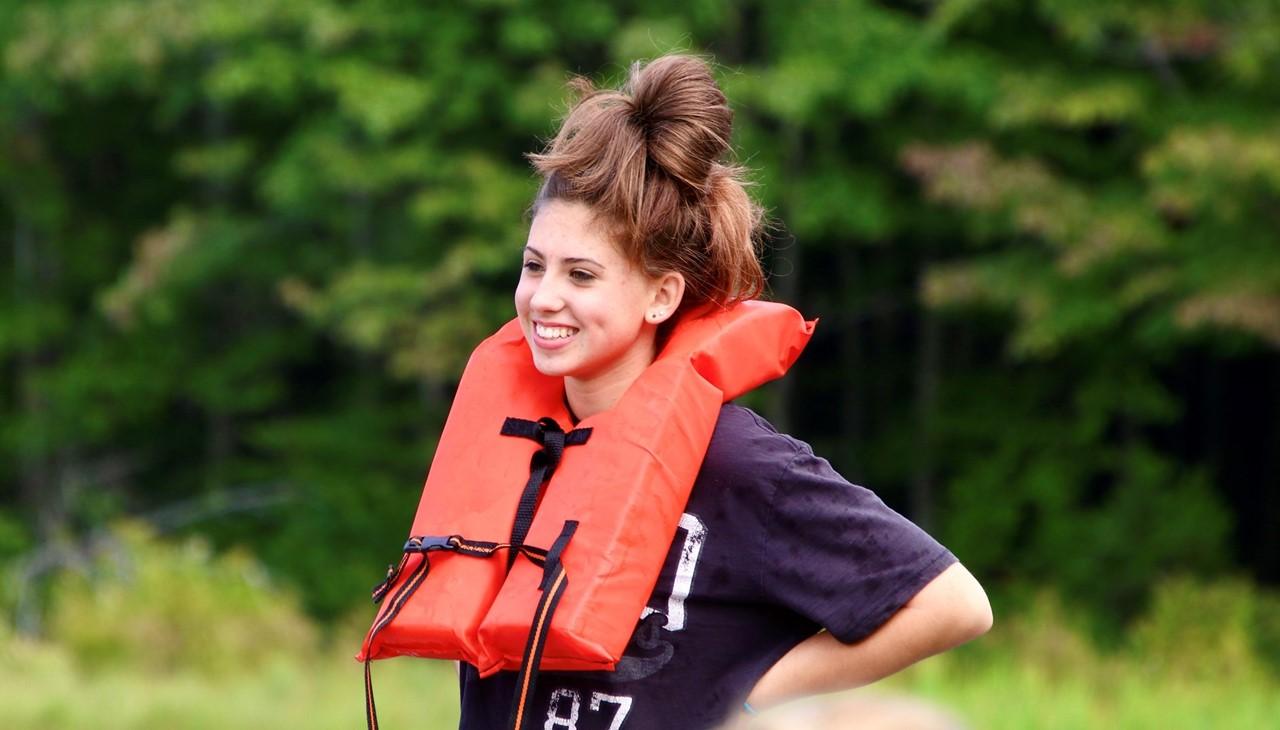 Bowman lake trip - girl with life jacket on smiling