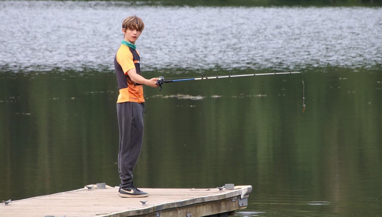 Bwman Lake trip - boy fishing on the dock