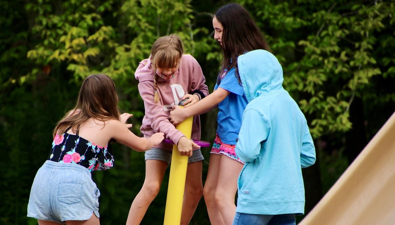 Bowman Lake Trip - girls paying on standing teeter tadder