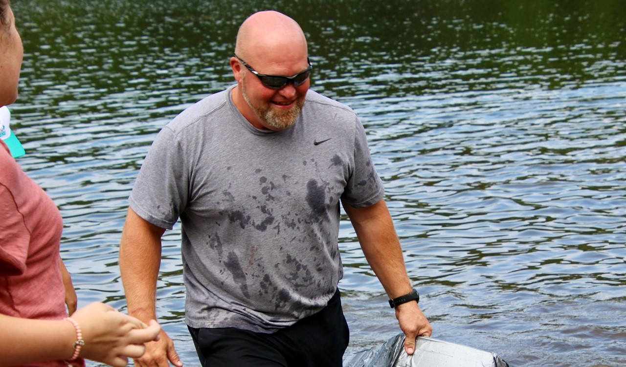 Bowman Lake trip - Mr. Holmquist rescuing a homemade boat