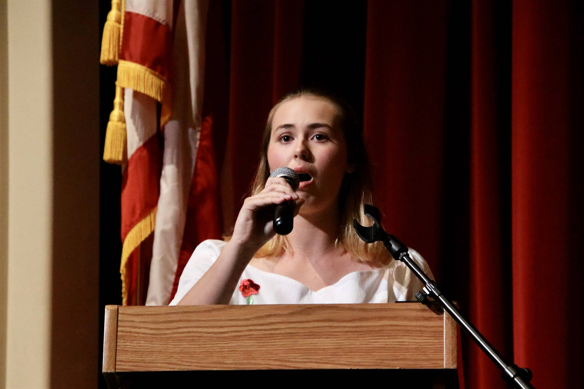 Student singing for Hall of Distinction ceremony