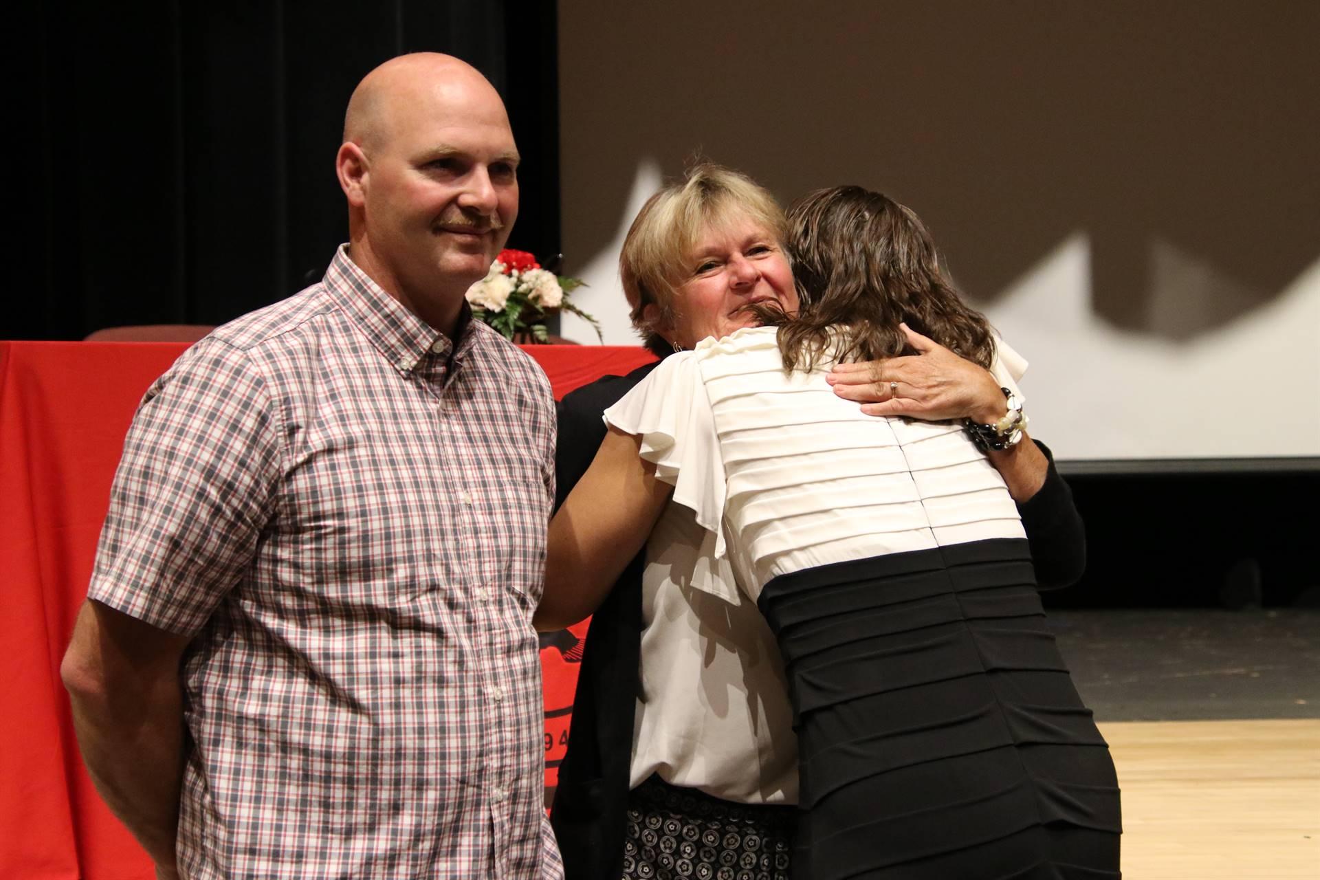 Hall of Distinction honoree hugging attendee