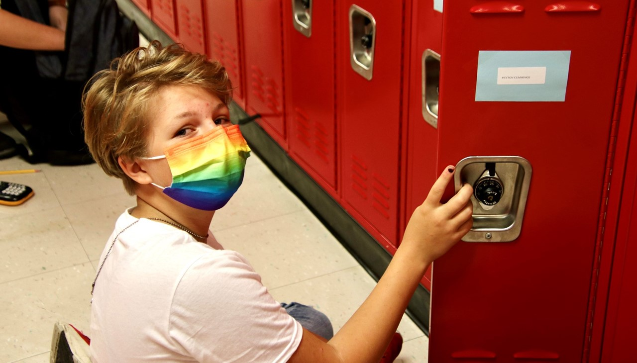 MS student getting into her locker