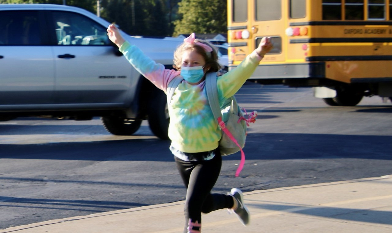 PS student running back to school
